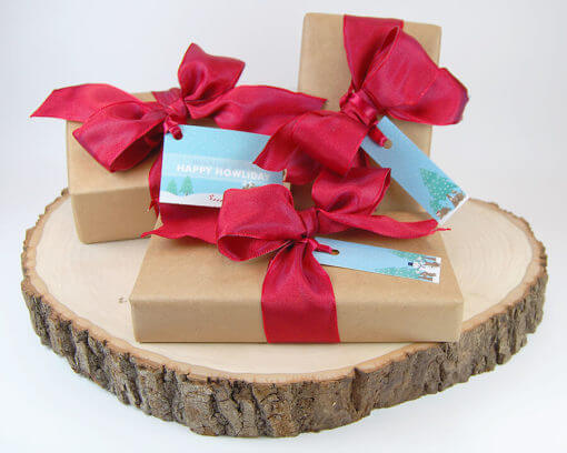 animal-christmas-gift-tag-set-on-presents sitting on cool log